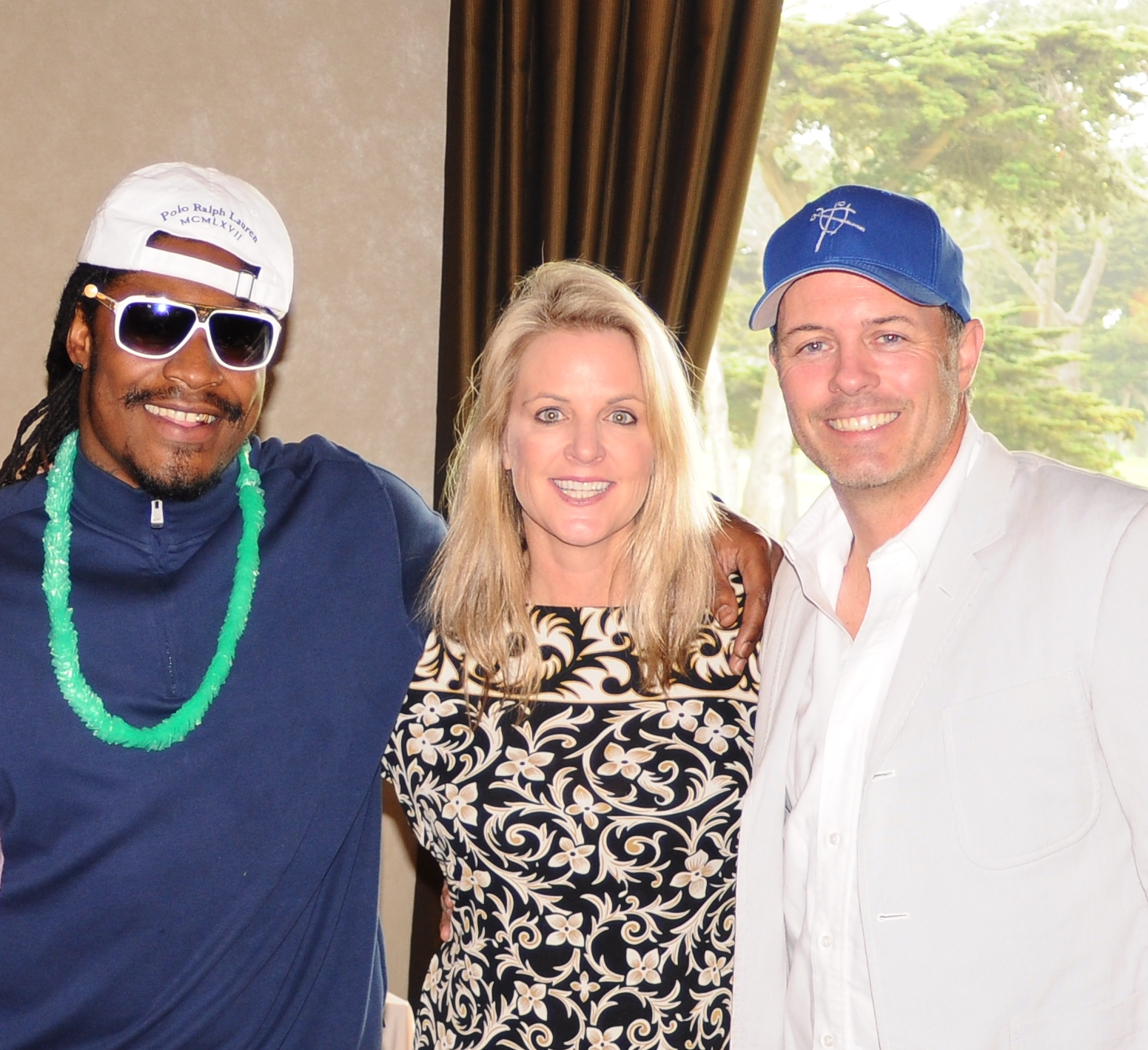 Marshawn Lynch of the Seattle Seahawks with Hilary and Geoff at the PlumpJack LINK Classic